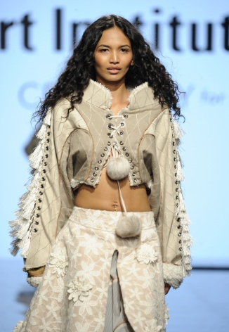 LOS ANGELES, CA - OCTOBER 12: A model walks the runway wearing Monique Petrossian at Art Hearts Fashion Los Angeles Fashion The Art Institutes Showcase on October 12, 2016 in Los Angeles, California. (Photo by Arun Nevader/Getty Images for Art Hearts Fashion)