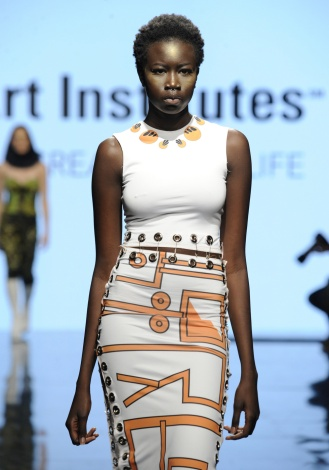 LOS ANGELES, CA - OCTOBER 12: A model walks the runway wearing Monique Charlie Petrossian at Art Hearts Fashion Los Angeles Fashion The Art Institutes Showcase on October 12, 2016 in Los Angeles, California. (Photo by Arun Nevader/Getty Images for Art Hearts Fashion)
