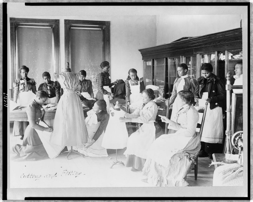 Young women cutting and fitting clothing in class at Agricultural and Mechanical College, Greensboro, N.C.