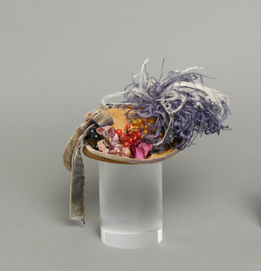 Mildred Blount miniature period hat; straw, braided, with silk velvet, ostrich feather, and plastic; 3 1/2 × 6 × 5 1/8 in. (8.89 × 15.24 × 13.02 cm); Gift of Marjorie St. Cyr (CR.75.2.23); courtesy of LACMA collections