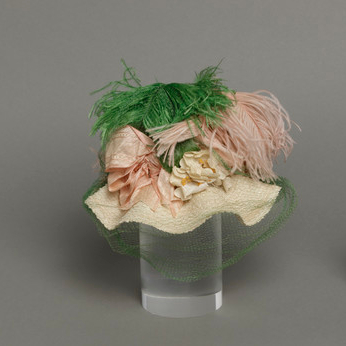 Mildred Blount miniature period hat; straw, braided, with silk plain weave (moiré) with silk supplementary warp patterning and ostrich feathers; 4 × 7 × 5 3/4 in. (10.16 × 17.78 × 14.61 cm); Gift of Marjorie St. Cyr (CR.75.2.27); courtesy of LACMA collections