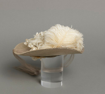 Mildred Blount miniature period hat; Silk velvet with silk plain weave, linen plain weave (buckrum), ostrich feather, and silk net; 2 1/2 × 8 3/4 × 8 3/4 in. (6.35 × 22.23 × 22.23 cm); Gift of Marjorie St. Cyr (CR.75.2.26); courtesy of LACMA collections